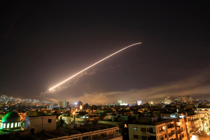 File - In this Saturday, April 14, 2018 file photo, air defense missiles are seen over Damascus as the U.S. launches an attack on Syria targeting different parts of the capital early. Syria's capital has been rocked by loud explosions that lit up the sky with heavy smoke as U.S. President Donald Trump announced airstrikes in retaliation for the country's alleged use of chemical weapons. (AP Photo/Hassan Ammar, File)