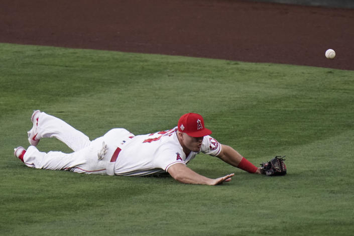 Los Angeles Angels' Mike Trout misses a double hit by Los Angeles Dodgers' AJ Pollock during the second inning of a baseball game, Friday, May 7, 2021, in Anaheim, Calif. (AP Photo/Jae C. Hong)