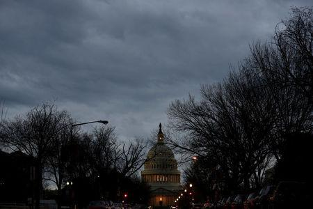 The U.S. Capitol is lit during the second day of a shutdown of the federal government in Washington, U.S., January 21, 2018. REUTERS/Joshua Roberts
