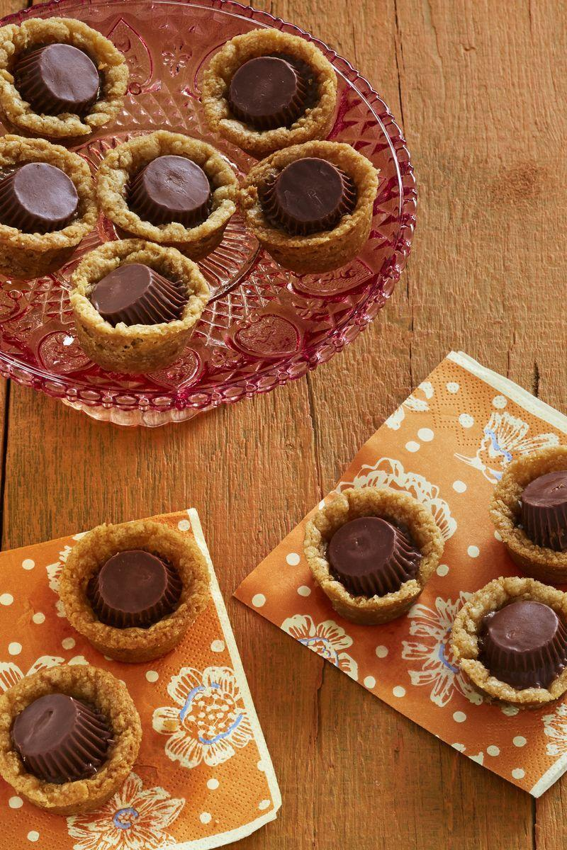 """<p>Use your stash of mini peanut butter cups to finish off these impossibly easy—and aptly named—Quick Peanut Butter-Chocolate Cookies.</p><p><strong><a href=""""https://www.thepioneerwoman.com/food-cooking/recipes/a34029810/quick-peanut-butter-chocolate-cookies-recipe/"""" rel=""""nofollow noopener"""" target=""""_blank"""" data-ylk=""""slk:Get the recipe."""" class=""""link rapid-noclick-resp"""">Get the recipe.</a></strong> </p><p><a class=""""link rapid-noclick-resp"""" href=""""https://go.redirectingat.com?id=74968X1596630&url=https%3A%2F%2Fwww.walmart.com%2Fsearch%2F%3Fquery%3Dpioneer%2Bwoman%2Bserving%2Bplatters&sref=https%3A%2F%2Fwww.thepioneerwoman.com%2Ffood-cooking%2Fmeals-menus%2Fg32110899%2Fbest-halloween-desserts%2F"""" rel=""""nofollow noopener"""" target=""""_blank"""" data-ylk=""""slk:SHOP SERVING PLATTERS"""">SHOP SERVING PLATTERS</a></p>"""