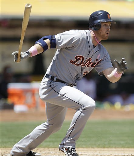 Detroit Tigers' Andy Dirks swings for a single off Oakland Athletics' Jarrod Parker during the inning of a baseball game Sunday, May 13, 2012, in Oakland, Calif. (AP Photo/Ben Margot)