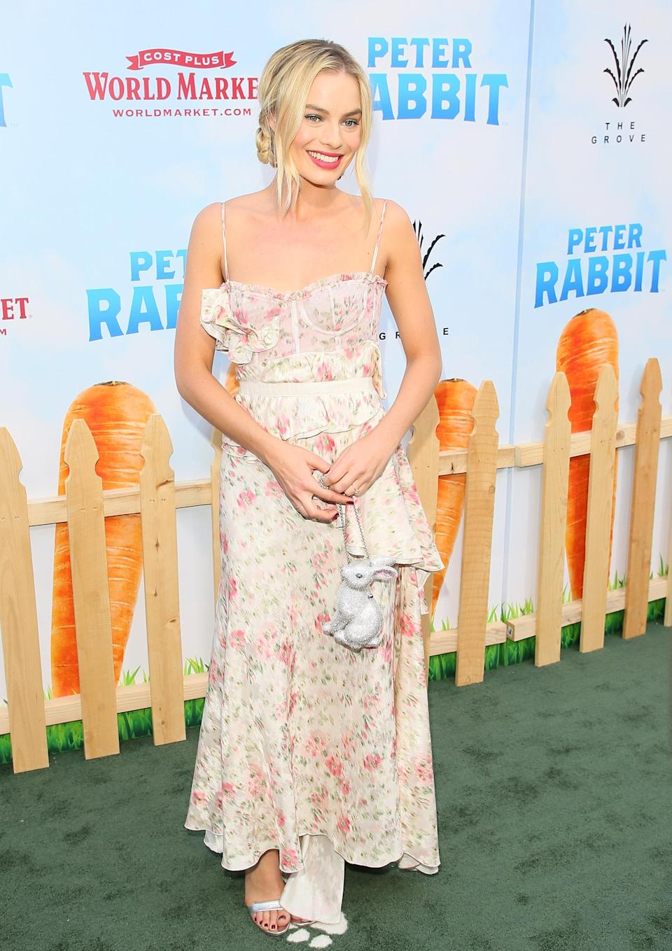 <p>The Aussie actress wore a summery dress by Brock Collection teamed with the perfect accessory: a rabbit clutch by Judith Leiber. <em>[Photo: Getty]</em> </p>