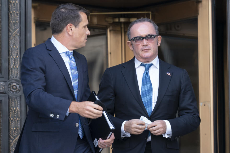 Igor Fruman, right, leaves in Federal court in Manhattan with his attorney Todd Blanche, Friday, Sept. 10, 2021. The Soviet-born Florida businessman who helped Rudy Giuliani seek damaging information about Joe Biden in Ukraine when Biden was running for president pleaded guilty in a case involving illegal campaign contributions. (AP Photo/Mary Altaffer)