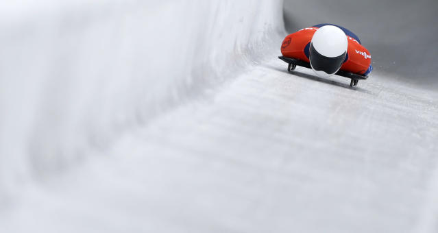 Matthew Antoine of the United States speeds down the track during his first run of the men's Skeleton World Cup race in Koenigssee, southern Germany, on Saturday, Jan. 25, 2014. (AP Photo/Matthias Schrader)