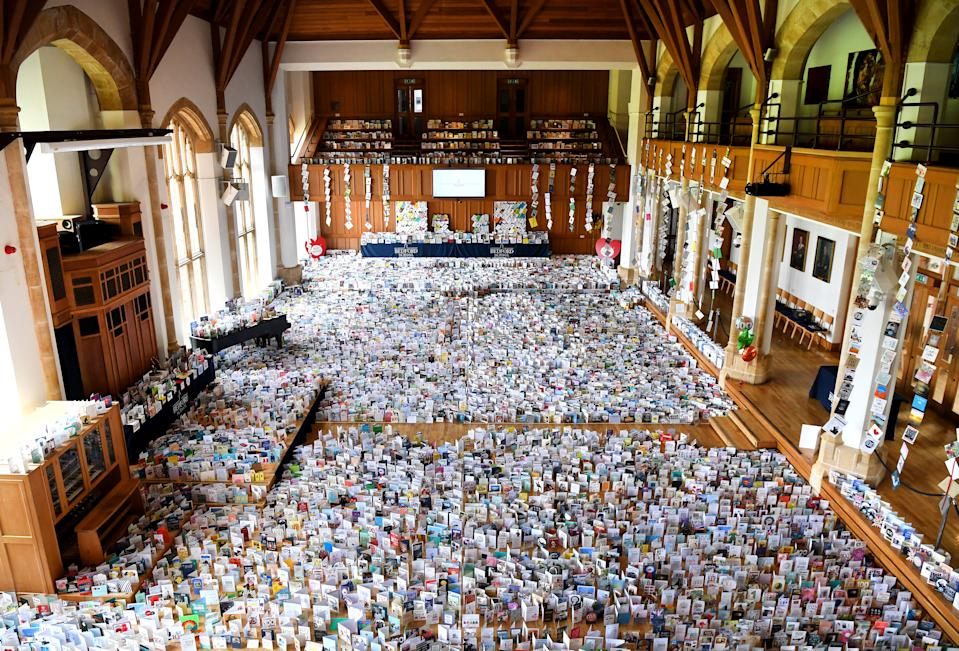 BEDFORD, ENGLAND - APRIL 29:  A general view of thousands of birthday cards sent to Captain Tom Moore for his 100th birthday on April 30th, are pictured displayed in the Hall of Bedford School, closed-down due to the COVID-19 pandemic, in Bedford, on April 29, 2020. - 99-year-old Moore raised just money for Britain's National Health Service (NHS) following the novel coronavirus outbreak, by walking 100 laps of his garden. (Photo by Shaun Botterill/Getty Images)