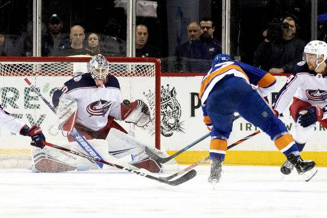 New York Islanders' Anders Lee (27) scores a goal past Columbus Blue Jackets goaltender Elvis Merzlikins (90) during the first period of an NHL hockey game, Saturday, Nov. 30, 2019, in New York. (AP Photo/Mary Altaffer)