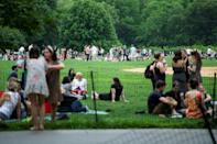 People gather in Central Park in New York on May 22, 2021 even though bars and restaurants have been allowed to open at full capacity for several days
