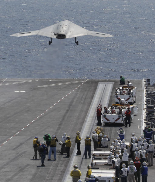 A X47-B Navy Drone is launched from the deck of the nuclear aircraft carrier USS George H. W. Bush off the Coast of Virginia Wednesday, July 10, 2013. It is the first landing by a drone on a Navy carrier. The landing of the X-47B experimental aircraft means the Navy can move forward with its plans to develop another unmanned aircraft that will join the fleet alongside traditional airplanes to provide around-the-clock surveillance while also possessing a strike capability. (AP Photo/Steve Helber)