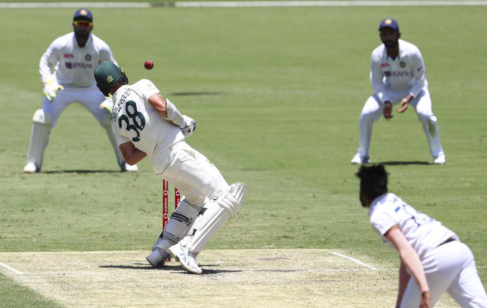 Australia's Josh Hazlewood avoids a bouncer from India's Mohammed Siraj during play on day two of the fourth cricket test between India and Australia at the Gabba, Brisbane, Australia, Saturday, Jan. 16, 2021. (AP Photo/Tertius Pickard)