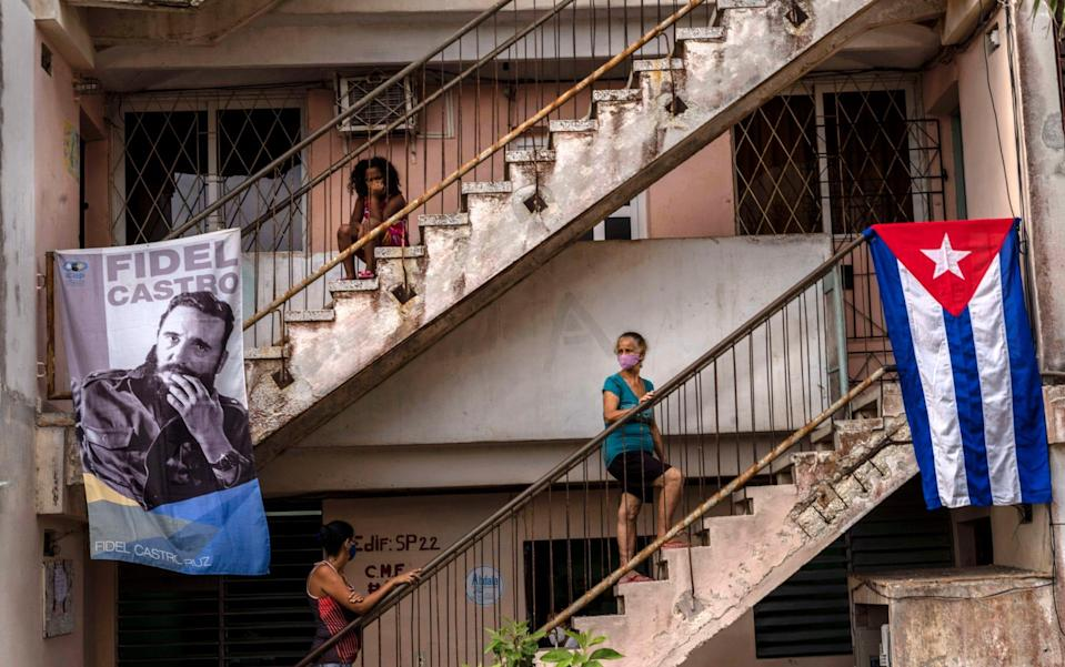 D doctor's office decorated with a Castro and a Cuban flag, in the Alamar neighborhood of Havana, Cuba - Ramon Espinosa/AP