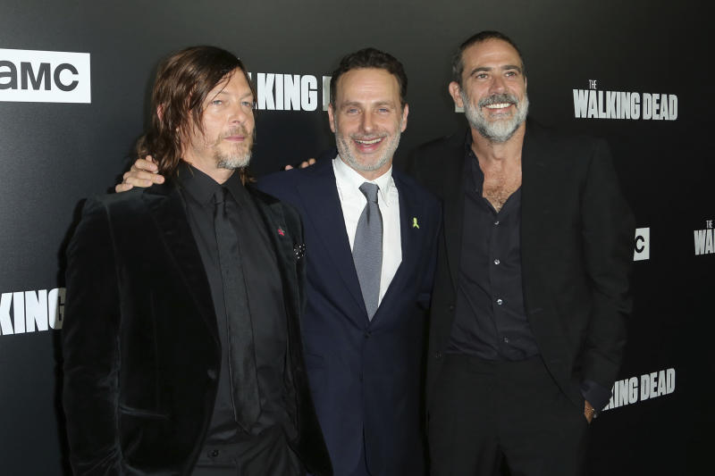 "FILE - In this Sept. 27, 2018 file photo, from left to right, Norman Reedus, Andrew Lincoln and Jeffrey Dean Morgan arrive at the LA Premiere of Season 9 of their show ""The Walking Dead""  in Los Angeles. The network behind the show that's become synonymous with Georgia says it will ""reevaluate"" its activity in the state if a new abortion law goes into effect. The Walking Dead's success has drawn steady streams of tourists to the Georgia towns where it has been filmed. A statement from AMC Networks calls the abortion legislation ""highly restrictive"" and says it will be closely watching what's likely to be ""a long and complicated fight"" over the law. Georgia's ban on virtually all abortions will take effect next year if it's not blocked in the courts. (Photo by Willy Sanjuan/Invision/AP, File)"