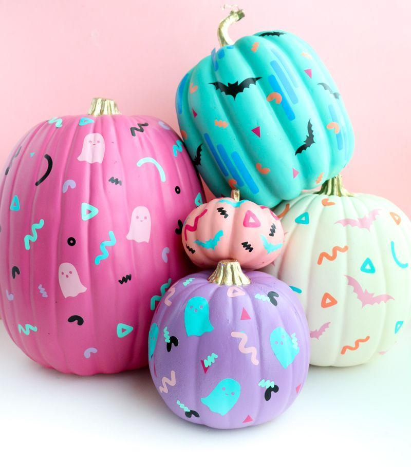 """<p>Why settle for adding just one face to your pumpkin when you could have multiple? For this easy ghost craft that (brightly!) nods to the 90s, you'll need colored adhesive vinyl and spray or acrylic paint.</p><p><em><a href=""""https://akailochiclife.com/2018/10/diy-90s-patterned-pumpkins.html"""" rel=""""nofollow noopener"""" target=""""_blank"""" data-ylk=""""slk:Get the tutorial at A Kailo Chic Life »"""" class=""""link rapid-noclick-resp"""">Get the tutorial at A Kailo Chic Life »</a></em></p>"""