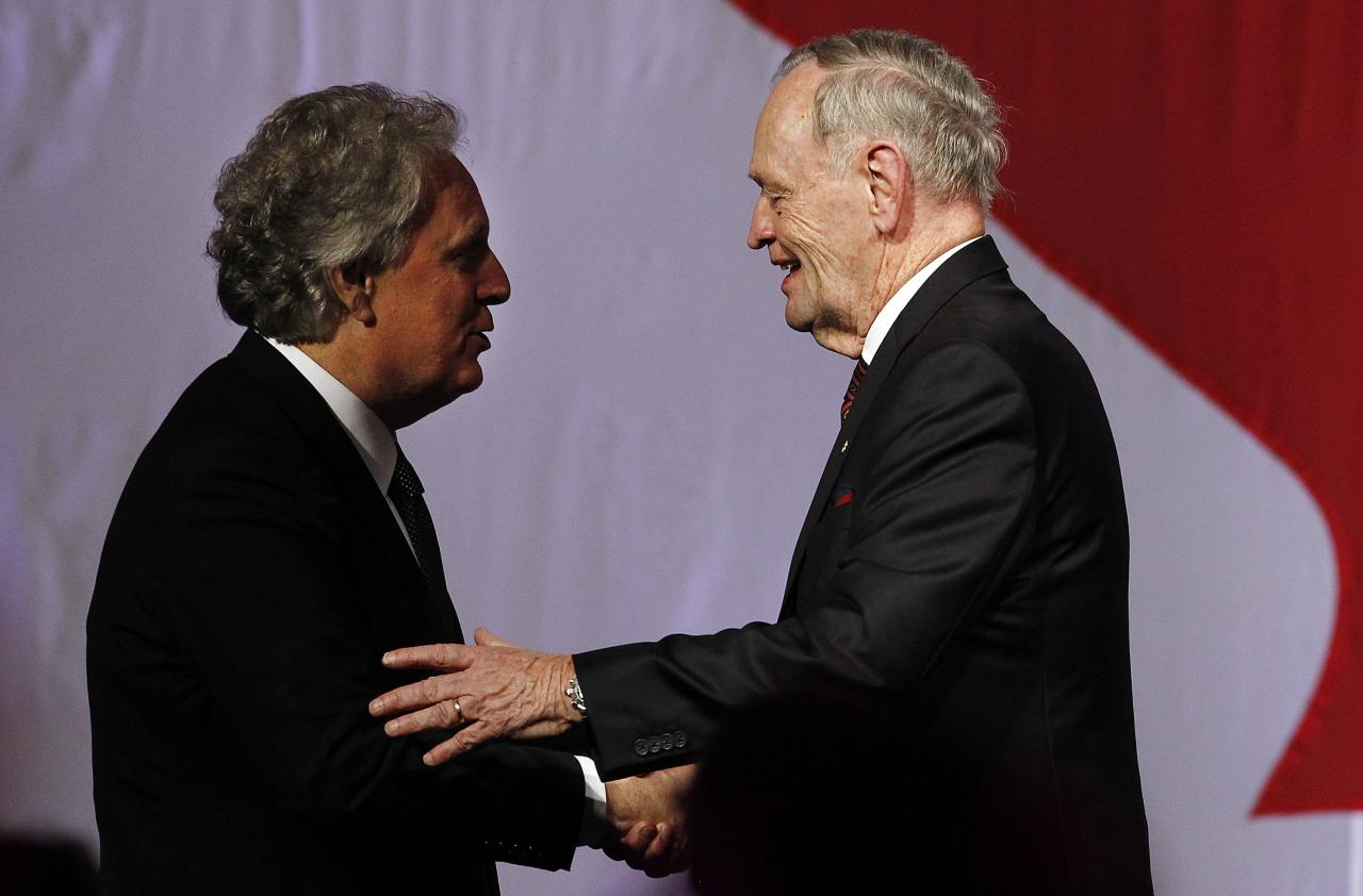 Jean Charest shakes hands with Jean Chretien at the 50 Years of Standing Up for Canada event in Toronto