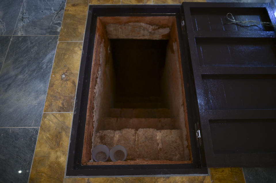 """The entrance to a crypt stands in the middle of the altar inside the second oldest Spanish church in the Americas, the San Jose Church, that will reopen following a massive reconstruction that took nearly two decades to complete, in San Juan, Puerto Rico, Tuesday, March 9, 2021. """"We let the church talk to you,"""" said architect Jorge Rigau, adding that people """"will find witnesses, ghosts, memories, scars."""" (AP Photo/Carlos Giusti)"""