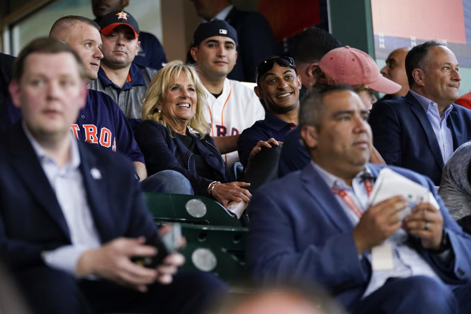 FILE - In this June 29, 2021, file photo first lady Jill Biden and Doug Emhoff sit with military members and first responders as they attend a baseball game between the Houston Astros and the Baltimore Orioles at Minute Maid Park, in Houston. (AP Photo/Carolyn Kaster, Pool, File)