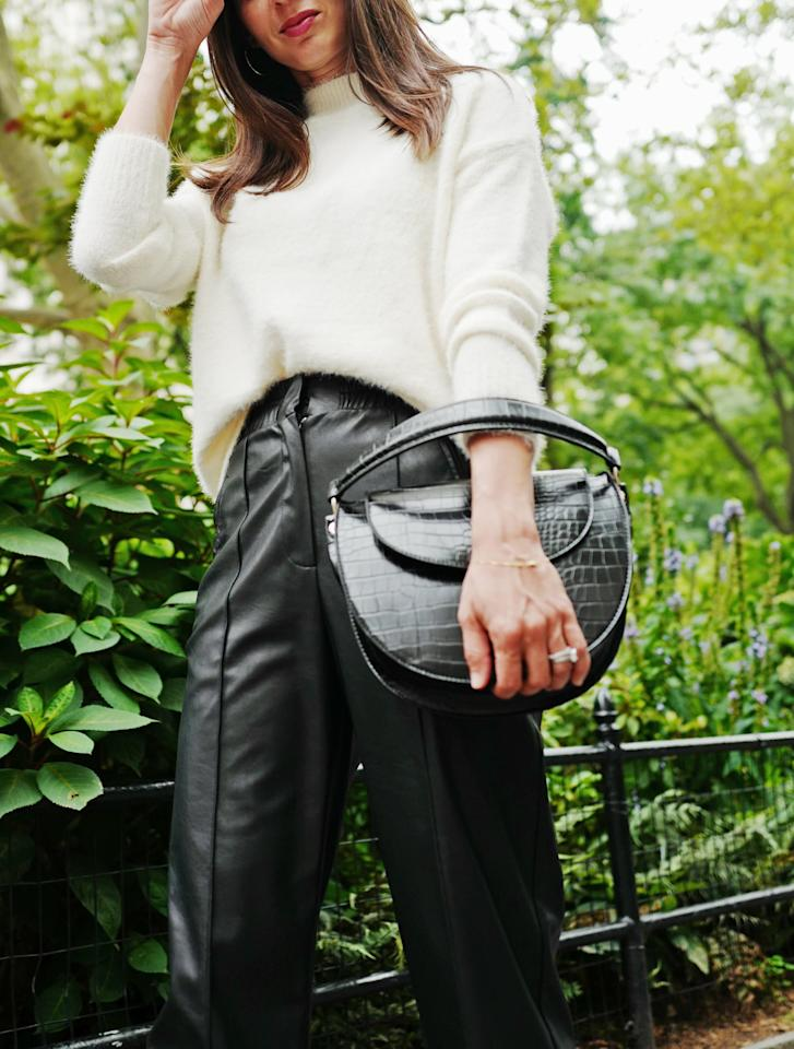 <p>Take a snuggly sweater in an edgy direction like Dana by styling with faux-leather pants and a croc-effect bag. </p>