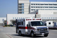 An ambulance leaves Harbor-UCLA Medical Center Wednesday, Feb. 24, 2021, in Torrance, Calif. Golfer Tiger Woods was hospitalized and underwent surgery at the hospital following a car accident on Tuesday. (AP Photo/Ashley Landis)