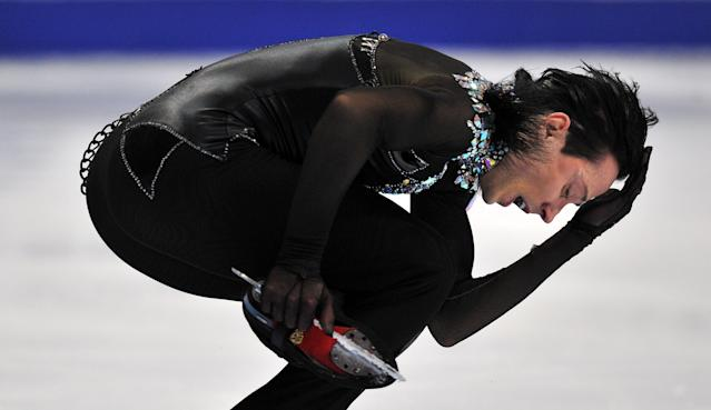 Johnny Weir of the United States performs on November 9, 2012 during the men's short program of the Russia's Cup, the fourth leg of ISU Grand Prix skating series, at the Megasport arena in Moscow. AFP PHOTO/ YURI KADOBNOVYURI KADOBNOV/AFP/Getty Images