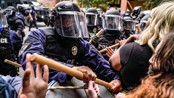 """Riot police intervene in protesters in Louisville on Wednesday. <p class=""""copyright"""">Ben Hendren/Anadolu Agency via Getty Images</p>"""