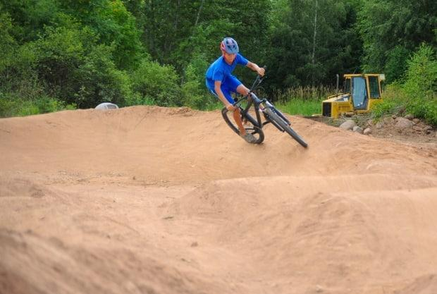 Andy Brake Seaward, seen in this 2020 photo, negotiates a berm, or banked turn, on a pump track in Pasadena, N.L.