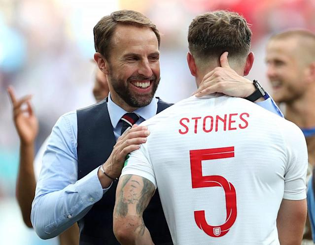 <p>Manager Gareth Southgate and defender John Stones celebrate after the final whistle. </p>