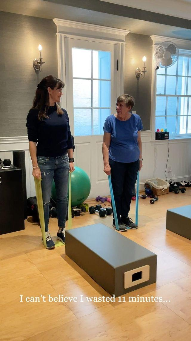 """<p>Pat Garner, Jennifer's mum, started exercising three years ago at 80 years old, according to a truly heartwarming video Jen shared on Instagram. And, when the two are in the same place, they sweat together.</p><p>A mix of walking, <a href=""""https://www.womenshealthmag.com/uk/gym-wear/a31691972/best-resistance-bands/"""" rel=""""nofollow noopener"""" target=""""_blank"""" data-ylk=""""slk:resistance band work"""" class=""""link rapid-noclick-resp"""">resistance band work</a>, <a href=""""https://www.womenshealthmag.com/uk/fitness/strength-training/a37686986/hammer-curl/"""" rel=""""nofollow noopener"""" target=""""_blank"""" data-ylk=""""slk:hammer curls"""" class=""""link rapid-noclick-resp"""">hammer curls</a> and <a href=""""https://www.womenshealthmag.com/uk/fitness/workouts/a701305/how-to-do-a-dumbbell-step-up/"""" rel=""""nofollow noopener"""" target=""""_blank"""" data-ylk=""""slk:step-ups"""" class=""""link rapid-noclick-resp"""">step-ups</a>, Pat is dedicated and motivated to close all the rings on her Apple Watch – something she'd done for over 241 days in a row. </p><p><a href=""""https://www.instagram.com/p/CP9RohVjoIC/"""" rel=""""nofollow noopener"""" target=""""_blank"""" data-ylk=""""slk:See the original post on Instagram"""" class=""""link rapid-noclick-resp"""">See the original post on Instagram</a></p>"""