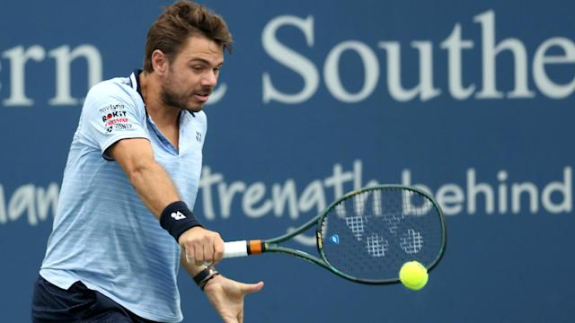 Stan Wawrinka prevailed in a topsy-turvy battle with Grigor Dimitrov, while Novak Djokovic and Roger Federer made it through to the last 16.