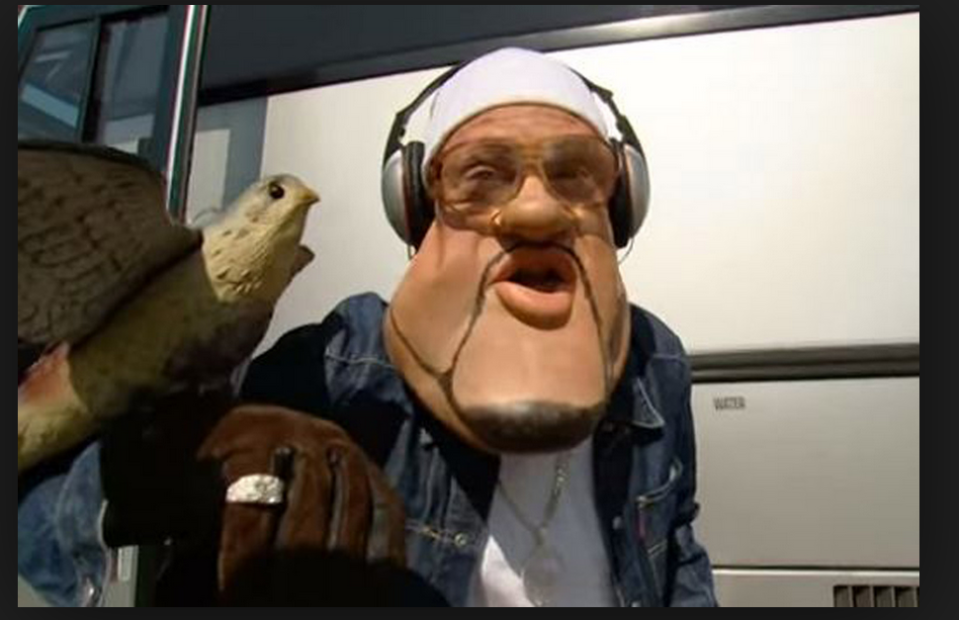 <p>A man (Leigh Francis) wearing a massive mask and walking around the streets of London… eventually destroying the street cred of celebrities like (Craig David. ITV/Talkback) </p>