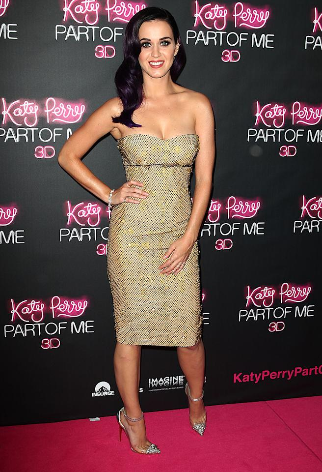 "Katy Perry can typically be found in our weekly <a target=""_blank"" href=""http://omg.yahoo.com/photos/what-were-they-thinking-06-15-slideshow/katy-perry-photo-1339634851.html"">What Were They Thinking?!</a> gallery, but, on this rare occasion, she's a member of the 2 Hot 2 Handle club thanks to the gold Versace bustier dress and silver Christian Louboutin pumps she wore to the Aussie premiere of her new docu-movie, <a target=""_blank"" href=""http://movies.yahoo.com/movie/katy-perry-part-of-me/"">""Katy Perry: Part of Me."" </a>(6/30/2012)"