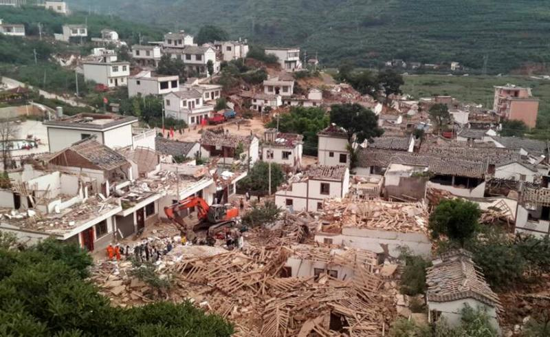 A general view shows collapsed houses after an earthquake hit Ludian county