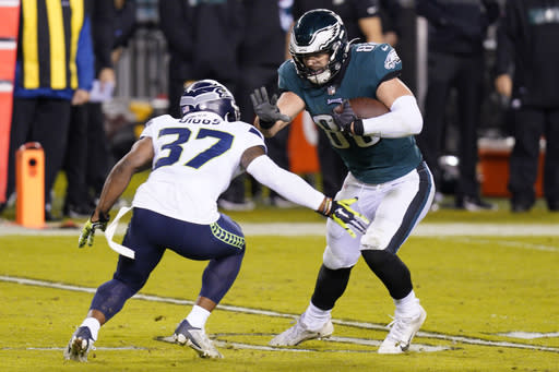 Philadelphia Eagles' Dallas Goedert (88) tries to get past Seattle Seahawks' Quandre Diggs (37) during the second half of an NFL football game, Monday, Nov. 30, 2020, in Philadelphia. (AP Photo/Chris Szagola)
