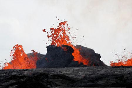 Lava from the Kilauea volcano pours out of a fissure, in the Leilani Estates near Pahoa, Hawaii, U.S., May 26, 2018.  REUTERS/Marco Garcia