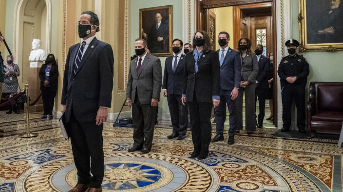 (L-R) Impeachment managers Representatives Jamie Raskin (D-MD), Diana DeGette (D-CO), David Cicilline (D-RI), Joaquin Castro (D-TX), Eric Swalwell (D-CA), Ted Lieu (D-CA), Stacey Plaskett (D-US Virgin Islands AT-Large), Joe Neguse (D-CO), and Madeleine Dean (D-PA) leave the Senate floor after delivering the article of impeachment on Capitol Hill on January 25, 2021 in Washington DC. (Melina Mara-Pool/Getty Images)