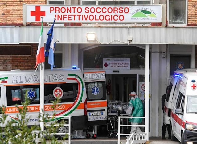 Nurses carry a Coronavirus Covid-19 patient with a high bio-containment stretcher in Italy (Getty)