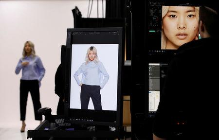 FILE PHOTO: A model is seen during a shooting session for Amazon Fashion at an unveiling of its new photo studio in Tokyo, Japan March 15, 2018.  REUTERS/Toru Hanai/File Photo