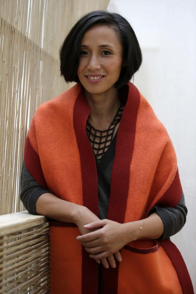 Jiang Qiong Er, Shang Xia's artistic director and chief executive, poses during a Chinese tea ceremony in Paris September 11, 2013. Shang Xia, the Chinese-born brand backed by French luxury goods group Hermes, opened its first shop outside its home market in Paris on Wednesday to test appetite among non-Chinese customers for its handcrafted products. The brand is trying to build a business centred on the revival of traditional Chinese crafts such as porcelain, cashmere felt and furniture, that were all but nearly destroyed by China's proletarian Cultural Revolution. REUTERS/Jacky Naegelen (FRANCE - Tags: FASHION BUSINESS)