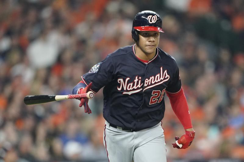 Washington Nationals' Juan Soto hits a home run during the fourth inning of Game 1 of the baseball World Series against the Houston Astros Tuesday, Oct. 22, 2019, in Houston. (AP Photo/David J. Phillip)