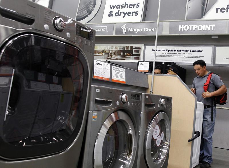 Shoppers look at washers and dryers at a Home Depot store in New York