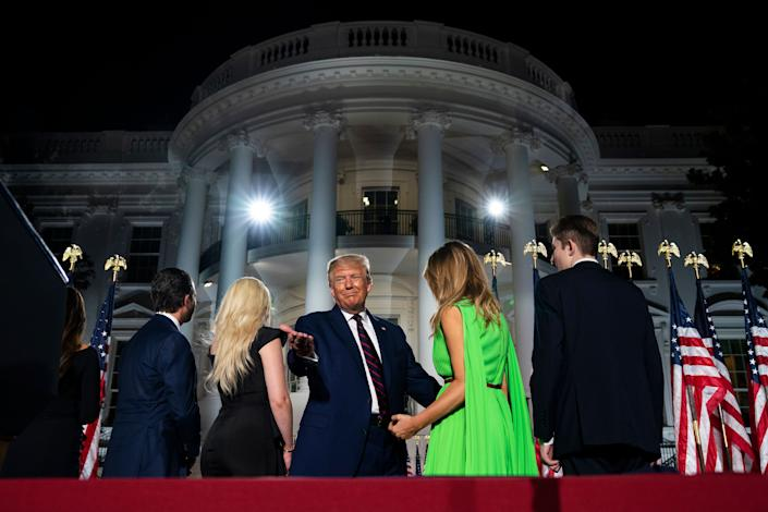 The president and his family standing before the White House — a federal government building they used as a prop for his personal political gain — during the GOP convention. (Photo: AP Photo/Evan Vucci)