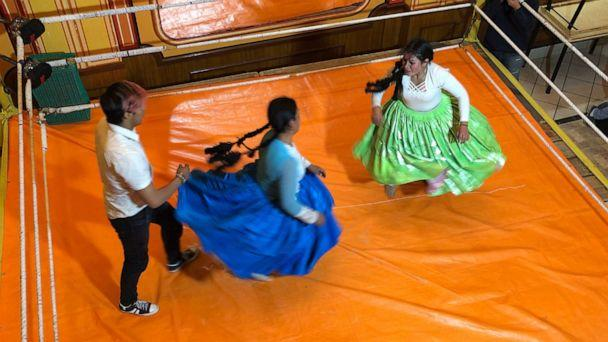 PHOTO: Cholita women wear large skirts and pigtails in the ring, and bowler caps outside of it. (Sarah Hucal/ABC News)