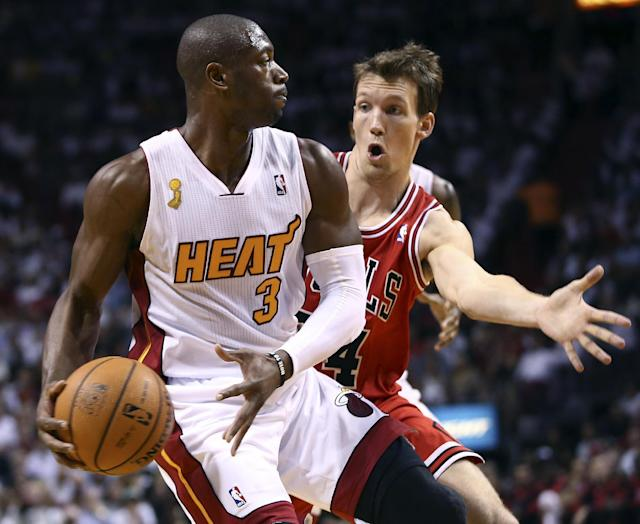 Chicago Bulls' Mike Dunleavy (34) forces Miami Heat's Dwyane Wade (3) to pass the ball during the first quarter of an NBA basketball game in Miami, Tuesday, Oct. 29, 2013. (AP Photo/J Pat Carter)