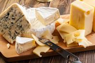"""<p>If you've invested in <a href=""""https://www.thedailymeal.com/travel/cheese-around-the-world-everyone-should-try?referrer=yahoo&category=beauty_food&include_utm=1&utm_medium=referral&utm_source=yahoo&utm_campaign=feed"""" rel=""""nofollow noopener"""" target=""""_blank"""" data-ylk=""""slk:fancy cheeses from around the world"""" class=""""link rapid-noclick-resp"""">fancy cheeses from around the world</a>, you don't want to let them go to waste. And if you store it in the airtight plastic wrapping it comes in, you just might be. Cheese needs to breathe, so ditch the plastic wrapping in favor of parchment or wax paper. These work to protect the cheese from picking up other flavors from odors circulating in your fridge but don't have the trapping effect of plastic. Another trick is to use olive oil. Brushing some olive oil on the open, cut surface of your cheese can help to trap moisture and protect your cheese from the surrounding air.</p>"""