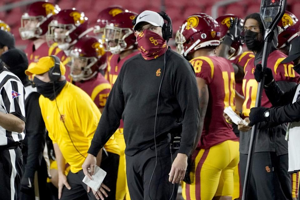USC coach Clay Helton looks on from the sideline during a win over Washington State on Dec. 6.