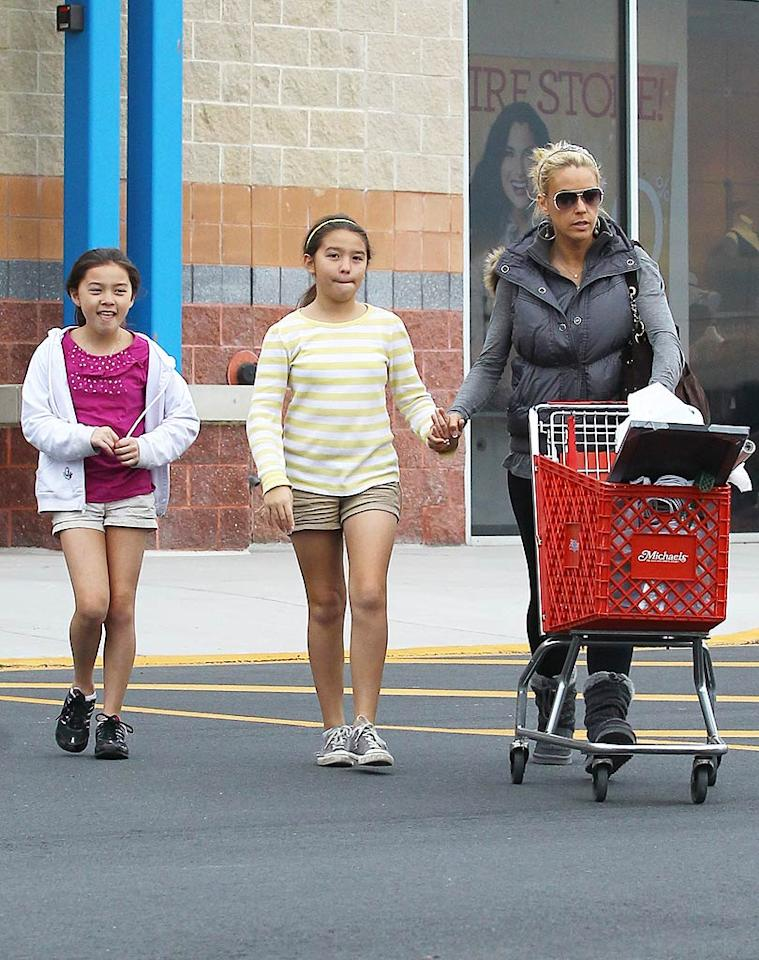 """Kate Gosselin and two of her eight children, 11-year-old twins Cara and Mady, hit the holiday sales at a Michaels arts and crafts store for some festive decorations in West Reading, Pennsylvania, on Friday. How else do you think the former """"Dancing With the Stars"""" diva can afford Christmas with so many kids?! (11/26/2011)"""