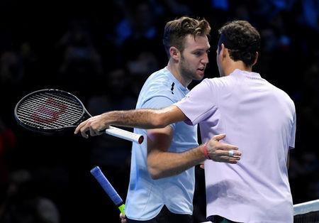 Tennis - ATP World Tour Finals - The O2 Arena, London, Britain - November 12, 2017 Switzerland's Roger Federer speaks with USA's Jack Sock after winning his group stage match Action Images via Reuters/Tony O'Brien