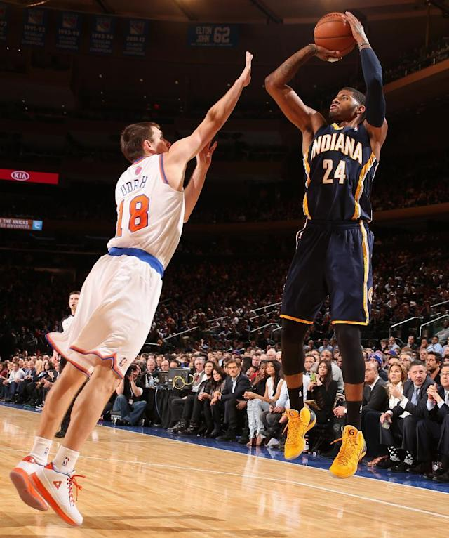 NEW YORK, NY - NOVEMBER 20: Paul George #24 of the Indiana Pacers shoots against Beno Udrih #18 of the New York Knicks during a game at Madison Square Garden in New York City on November 20, 2013. (Photo by Nathaniel S. Butler/NBAE via Getty Images)