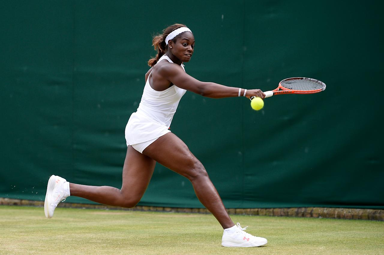 LONDON, ENGLAND - JULY 01: Sloane Stephens of United States of America plays a backhand during her Ladies' Singles fourth round match against Monica Puig of Puerto Rico on day seven of the Wimbledon Lawn Tennis Championships at the All England Lawn Tennis and Croquet Club on July 1, 2013 in London, England. (Photo by Dennis Grombkowski/Getty Images)