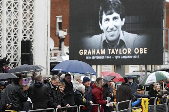 Wellwishers wait outside the church before the funeral service of former England and Watford manager Graham Taylor in Watford on February 1, 2017 (AFP Photo/Adrian DENNIS)
