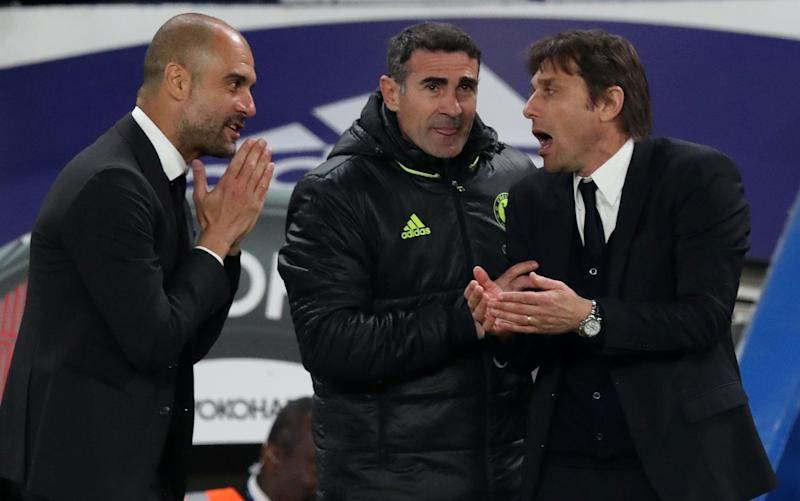 Pep Guardiola and Antonio Conte exchange views at Stamford Bridge - Rex Features