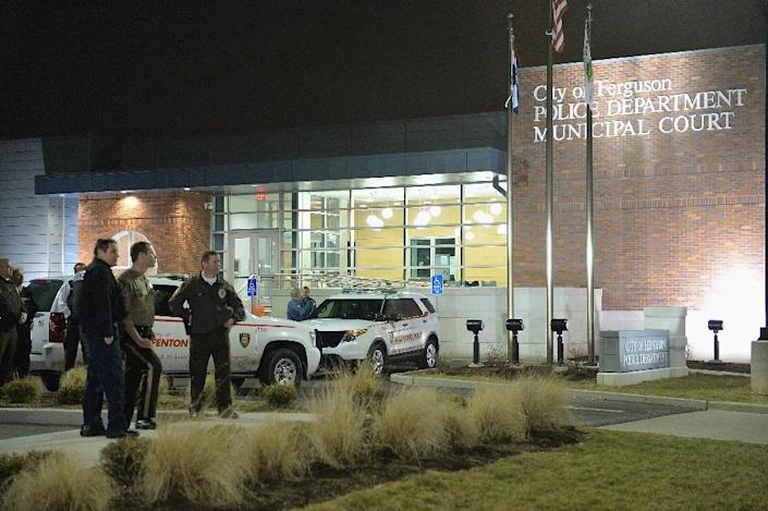 Police officers stand on watch outside the Ferguson Police Department in Ferguson, Missouri on March 12, 2015 during protests (AFP Photo/Michael B. Thomas)